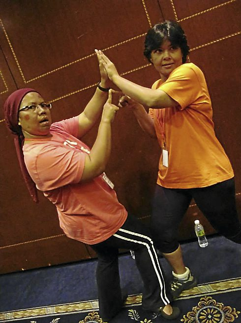 Touchy, feely: Azhariah Kamin and Sonja Mustaffa sportingly get connected.
