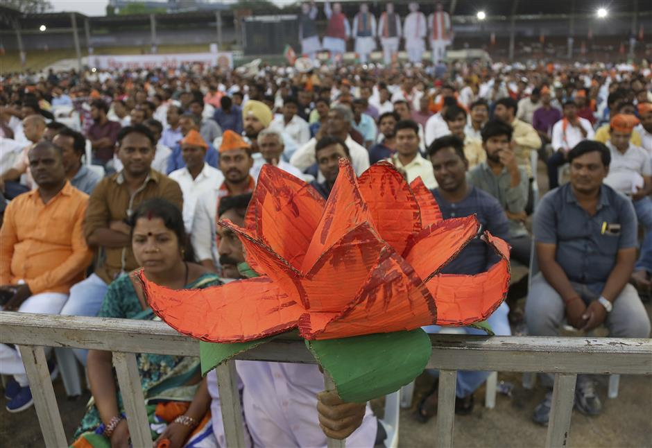 India's ruling Bharatiya Janata Party (BJP) supporters attend an election campaign rally in Hyderabad, India, Monday, April 1, 2019. India's general elections will be held in seven phases starting April 11. (AP Photo/Mahesh Kumar A.)
