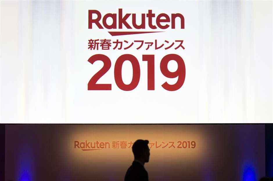 Signage is displayed at Rakuten Inc.\'s new year conference in Tokyo, Japan, on Wednesday, Jan. 30, 2019. Rakuten\'s chief executive officer Hiroshi Mikitani says the company is aiming to lower prices in Japan\'s wireless market. Photographer: Tomohiro Ohsumi/Bloomberg