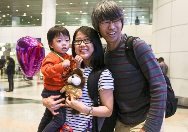 (From left) Jayden with his parents Tan and Ban at KLIA.