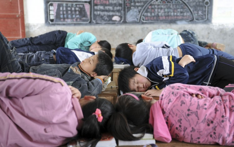 Chinese school says student punished for using toilet during nap