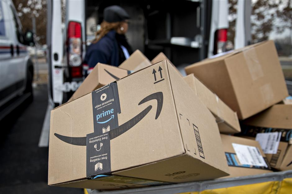 An Amazon.com Inc. package sits in a bin before being placed on a delivery vehicle at the United States Postal Service (USPS) Joseph Curseen Jr. and Thomas Morris Jr. processing and distribution center in Washington, D.C., U.S., on Tuesday, Dec. 12, 2017. The USPS said it expects to deliver over 15 billion total pieces of mail this holiday season with expanded Sunday delivery operations in certain areas, delivering over six million packages each Sunday in December. Photographer: Andrew Harrer/Bloomberg