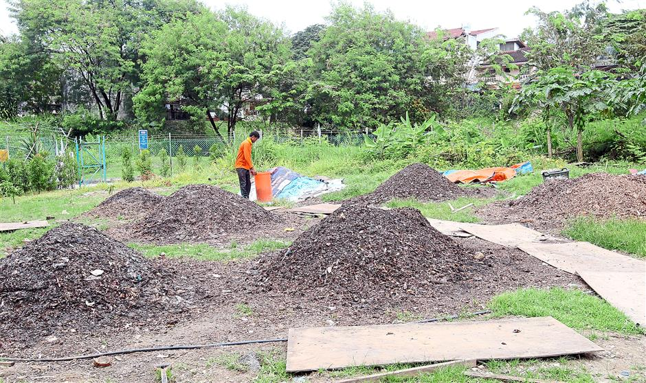 After four to five weeks, these heaps of food and garden waste would been transformed into useful compost. Photo: AZHAR MAHFOF/The Star