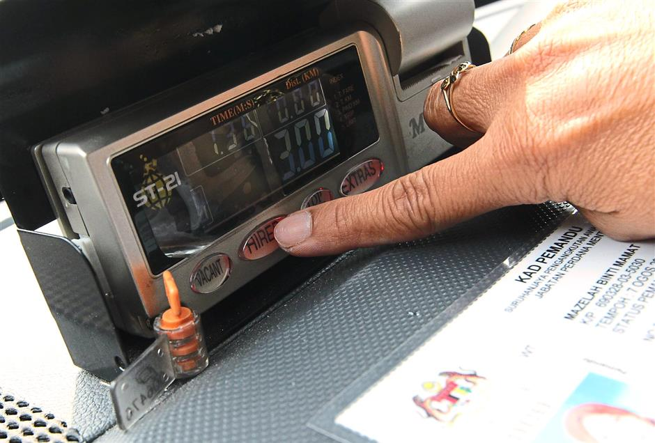 New start: A taxi driver re-setting a taxi meter.