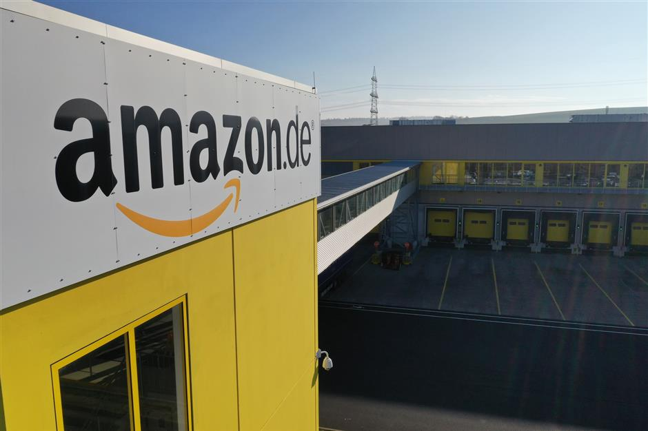 An Amazon.com Inc. logo sits on the exterior of the company\'s fulfilment center in Koblenz, Germany, on Friday, Nov. 23, 2018. Germans are expected to buy about 2.4 billion euros worth of goods on Black Friday and Cyber Monday, an increase of about 15 percent over last year. Photographer: Alex Kraus/Bloomberg