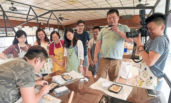Participants are taught how to make cookies during a cooking demo at a Taiwan Fairy Lake Leisure farm.