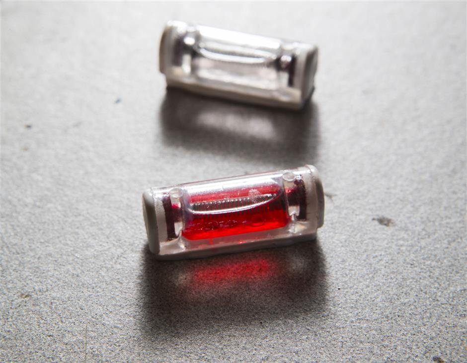 Tozuda LLC was a finalist in last year's Stellar Start-Ups contest. Based in South Philadelphia, it manufactures simple head-impact sensors. Its patented technology allows the detection of impacts without the use of electronics. The sensor simply releases a red dye. JThe device is shown before and after an impact on May 17, 2018. (Charles Fox/Philadelphia Inquirer/TNS)