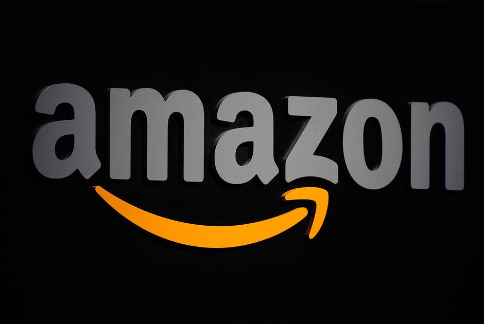 The Amazon logo is seen on a podium during a press conference in New York, September 28, 2011. Amazon CEO Jeff Bezos introduced a line of four new Kindle products, the Kindle Fire tablet, the Kindle Touch 3G, the Kindle Touch and a new lighter and smaller Kindle. AFP PHOTO/Emmanuel Dunand