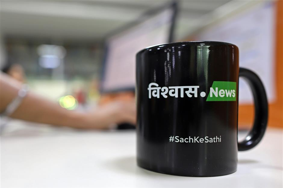 A promotional mug for Vishwas News, operated by Jagran New Media, reads 'Sach Ke Sathi' which translates as 'Friends of Facts' sits on a desk at the Vishwas office in New Delhi, India, on Friday, May 17, 2019. Facebook, Twitter Inc. and Google parent Alphabet Inc. are discovering the harsh reality that disinformation and hate speech are even more challenging in emerging markets than in places like the U.S. or Europe. Vishvas, Facebook's largest Indian-language fact-checking contractor, faces the challenge of working in country with 23 official languages. Photographer: Anindito Mukherjee/Bloomberg