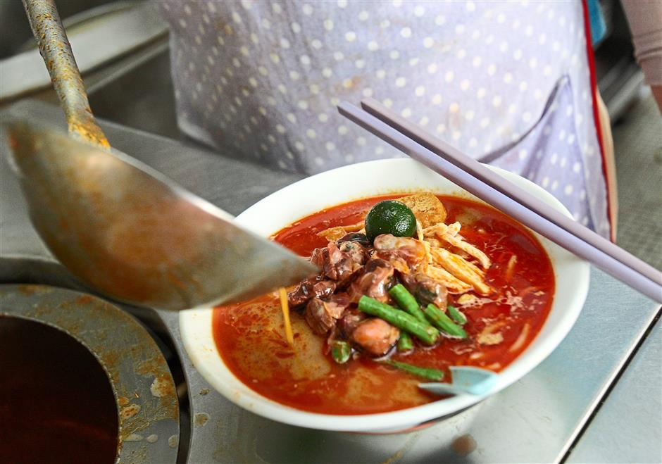 One hot dish: A bowl of curry laksa from the Sisters Curry Laksa stall.