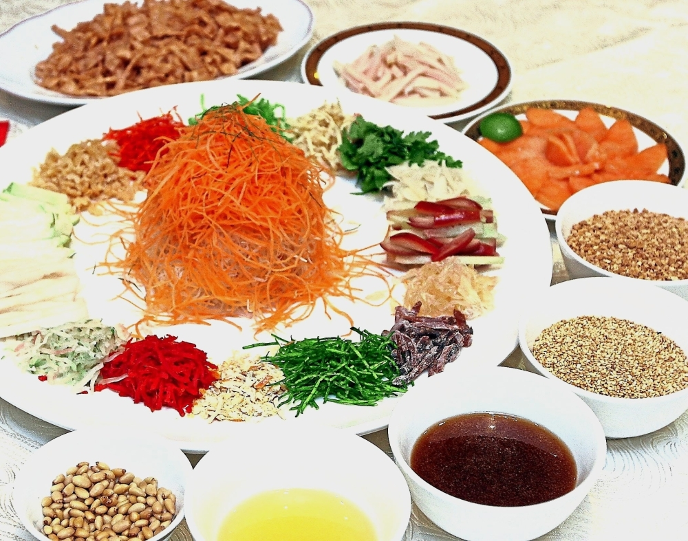 Pear and Salmon Yee Sang to usher in the Year of the Pig. — Photos: SAMUEL ONG/The Star