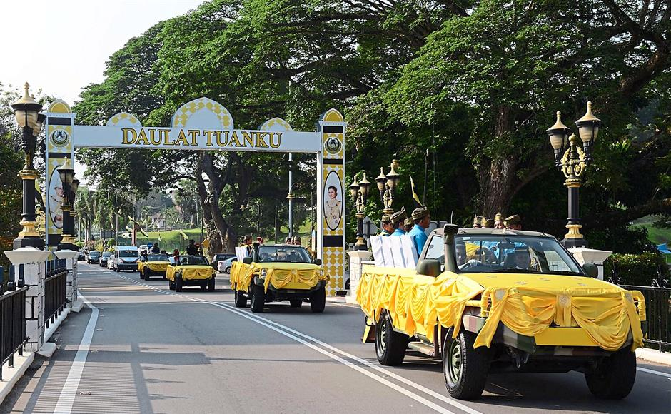 Decked in royal colours: The vehicles used to transport the water from Tujuh Kuala Sungai Perak for the '?Bersiram Tabal' ritual.
