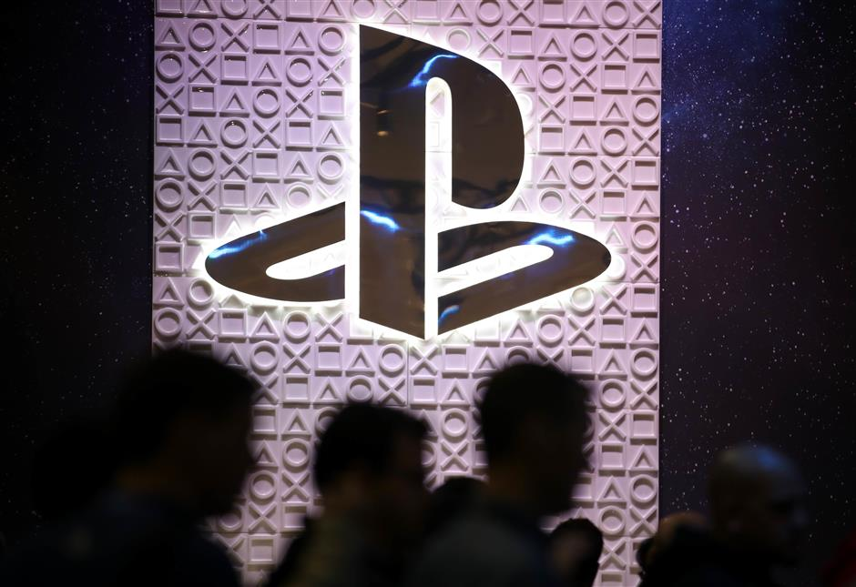 SAN FRANCISCO, CALIFORNIA - MARCH 20: Attendees walk by the Sony PlayStation booth at the 2019 GDC Game Developers Conference on March 20, 2019 in San Francisco, California. The GDC runs through March 22.   Justin Sullivan/Getty Images/AFP == FOR NEWSPAPERS, INTERNET, TELCOS & TELEVISION USE ONLY ==