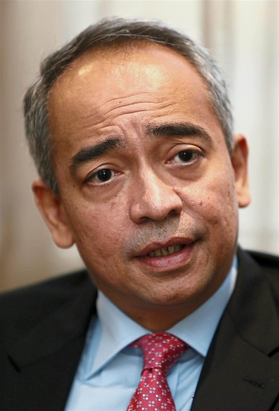 The face of CIMB: Nazir (inset) has spent close to three decades at the banking group, with 15 of those years as CEO.