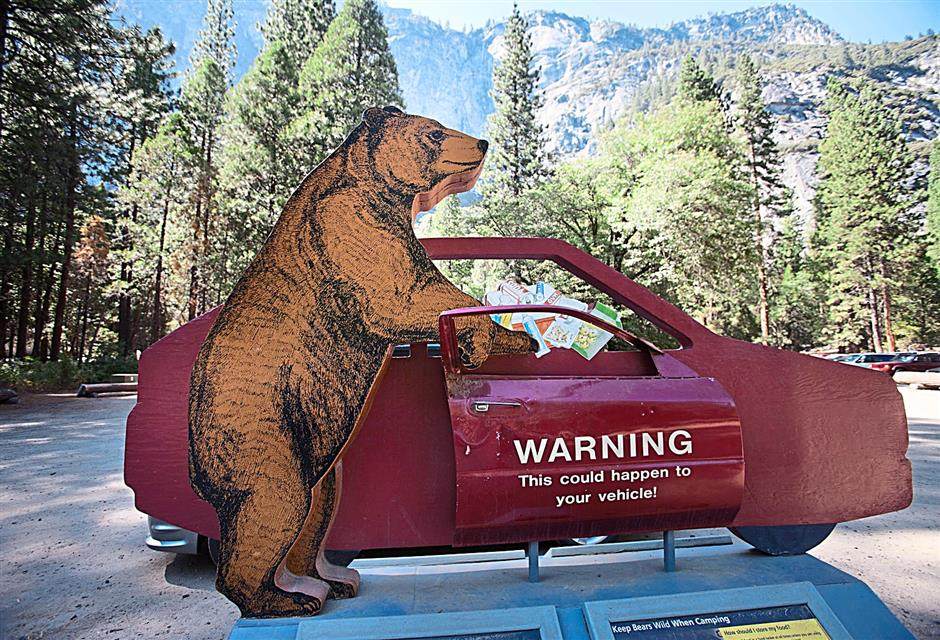An informational display in a parking lot warns visitors about the risk of leaving food in vehicles.