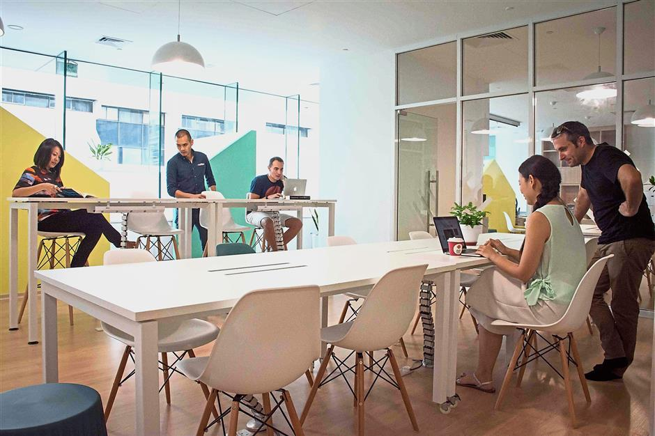 Trehaus co-working space uses bright, and chic interior design for the members working section.