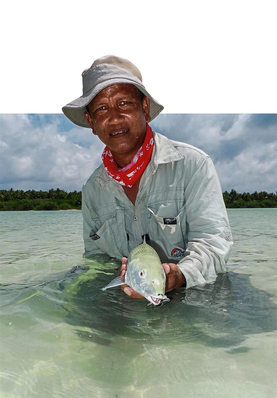 An angler showing his catch. Fishing enthusiasts are prepared to pay top dollar to hunt the bonefish, which are found only in a few places.