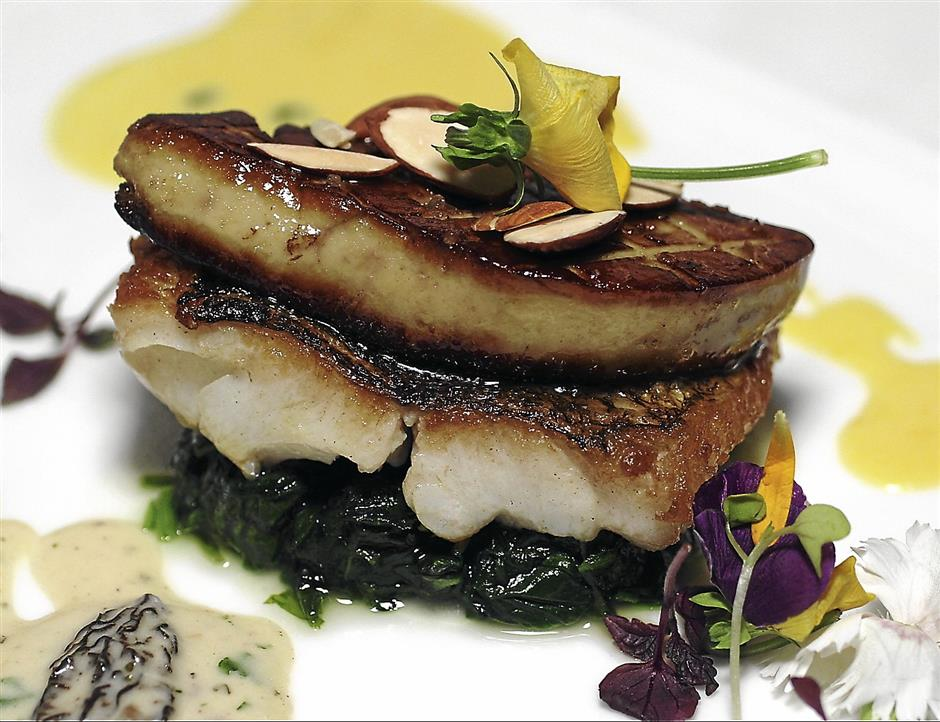 Pan-roasted Goby Fish with Spinach, Duck Liver and Cream Sauce is a well composed dish.