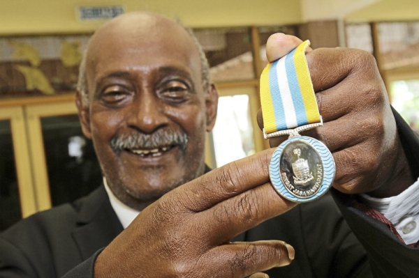 Proud moment: Sanmuggam showing his PJM medal after the investiture ceremony.