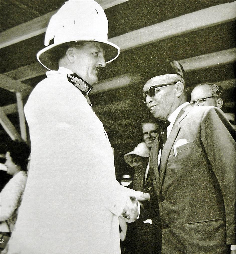 The last British governor Sir Alexander Waddel saying goodbye to his successor Datuk Abang Openg Abang Sapi'ee on Sept 15, 1963.