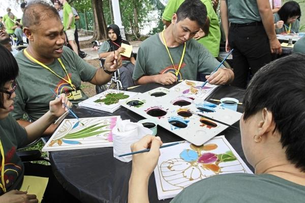 Participants painting batik at the 14th Penang Cheshire Agoonoree at Penang Water Sport Recreation Centre in Tanjung Bungah, Penang. StarPicby:LIM BENG TATT/The Star/23 March 2019.