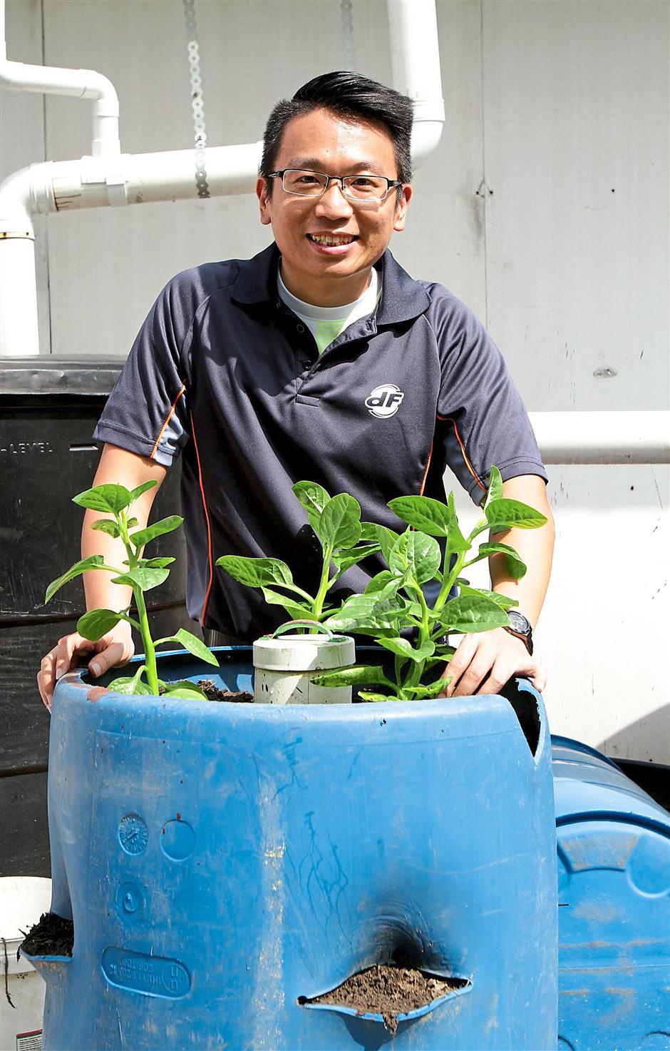 6 selangor urban farming association president jeff kong showing a sample of the drum in which vegetables and other crops could be grown.