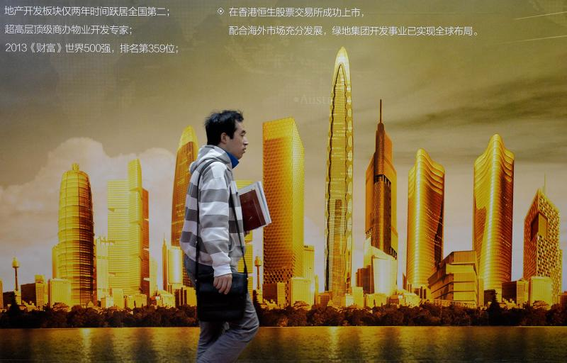The OECD has revised down its prediction in November that China\'s economy could grow to 8.2% in 2014 to 7.4% - AFP Photo.