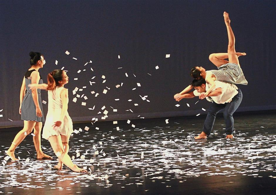 The Universiti Malaya Contemporary Dance Company performing at ICONDE during its inaugural conference in 2014 .