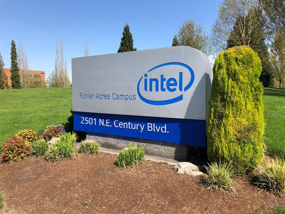 FILE PHOTO: A sign outside the Intel corporate campus in Hillsboro, Oregon, U.S., April 25, 2018. REUTERS/Caroline Humer/File Photo
