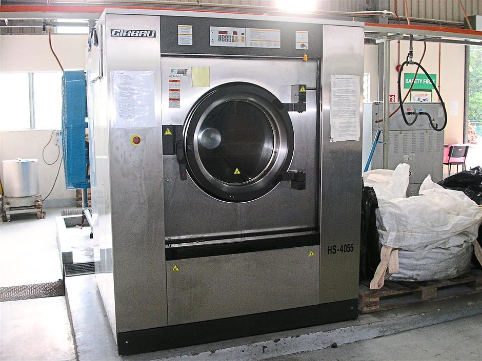 Promoting reuse: One of the industrial washing machines at 3R Quest's facility used to clean materials contaminated with scheduled wastes.