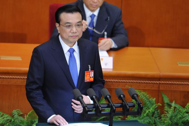 Chinese premier Li Keqiang delivers a report during the opening session of the 12th National People\'s Congress (NPC) in the Great Hall of the People in Beijing on March 5, 2014. China\'s annual show of political theatre, the National People\'s Congress, opens this week - AFP Photo.