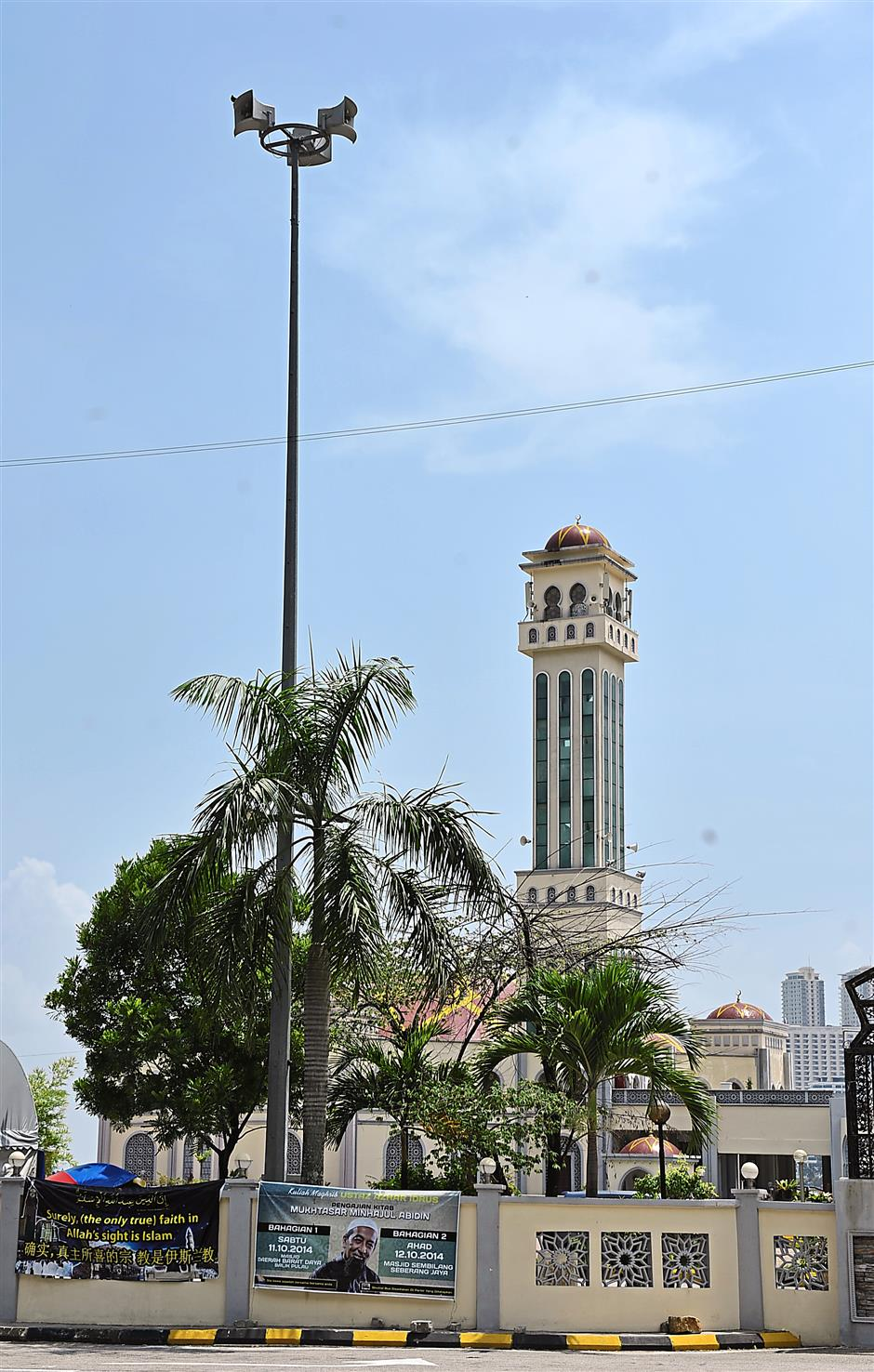 The high, imposing structure of tsunami siren that has been installed here at the Tanjung Bungah mosque in Penang, one of the many that has been erected as part of the country's early warning system. — GARY CHEN/The Star