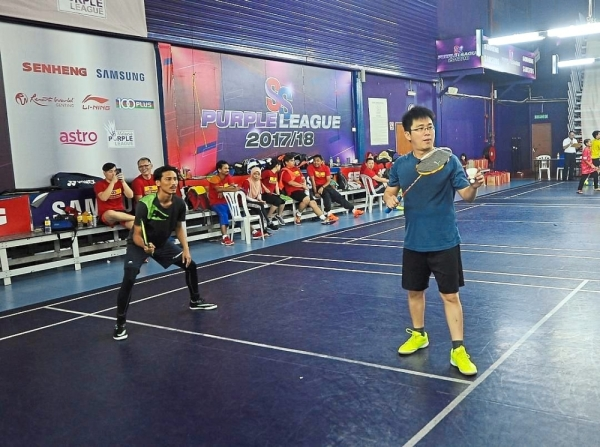 StarSports pair Hafeez (left) and Fock Yong in action during the Men's Doubles match.
