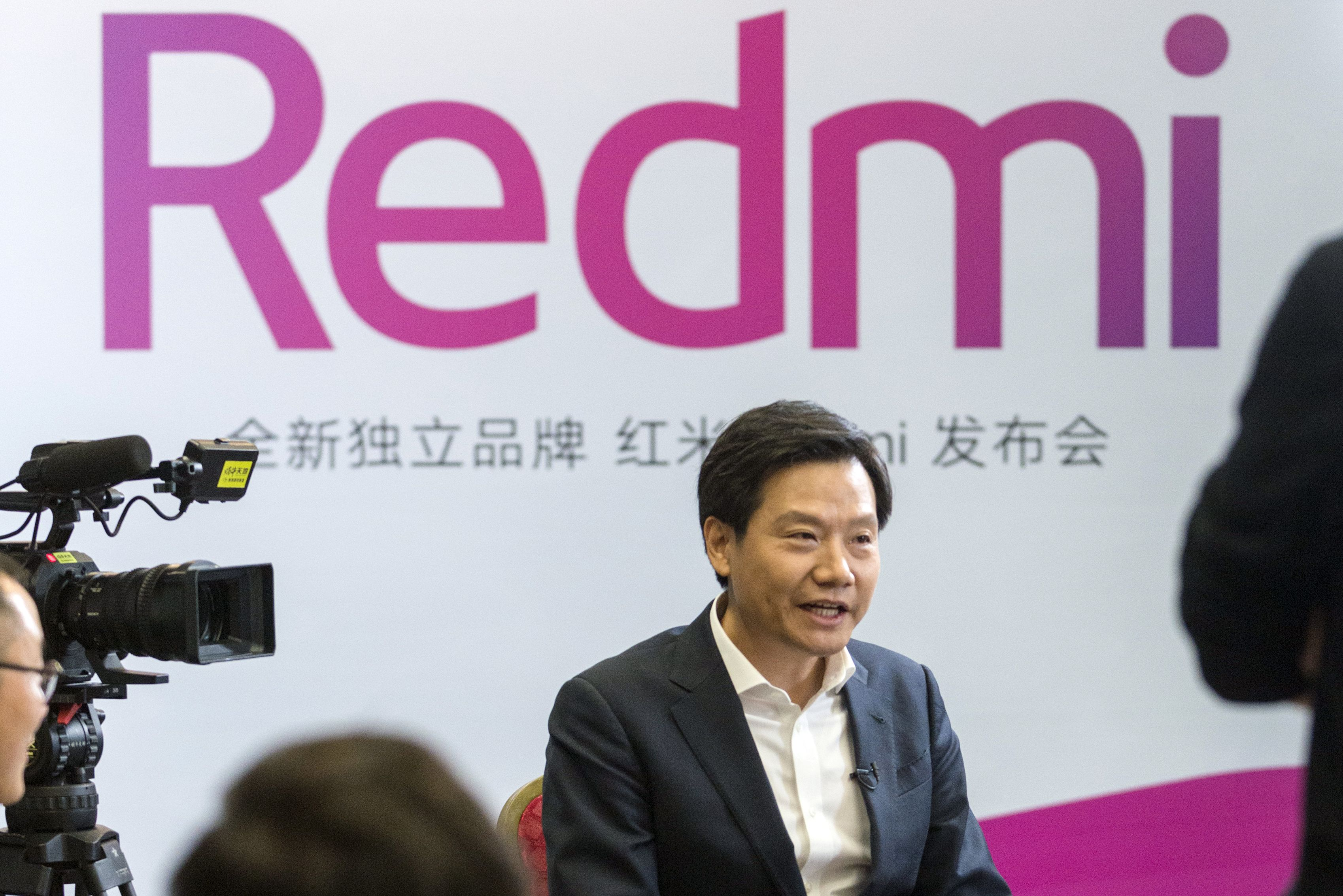 Lei Jun, chief executive officer of Xiaomi Corp., speaks during a Bloomberg Television interview following a product launch for the Redmi Note 7 smartphone in Beijing, China, on Thursday, Jan. 10, 2019. Xiaomi's billionaire co-founder, shrugging off a share slump thatu2019s wiped $6 billion off its market value in just three days, expects the advent of next-generation wireless to energize demand for its smartphones. Photographer: Shawn Koh/Bloomberg