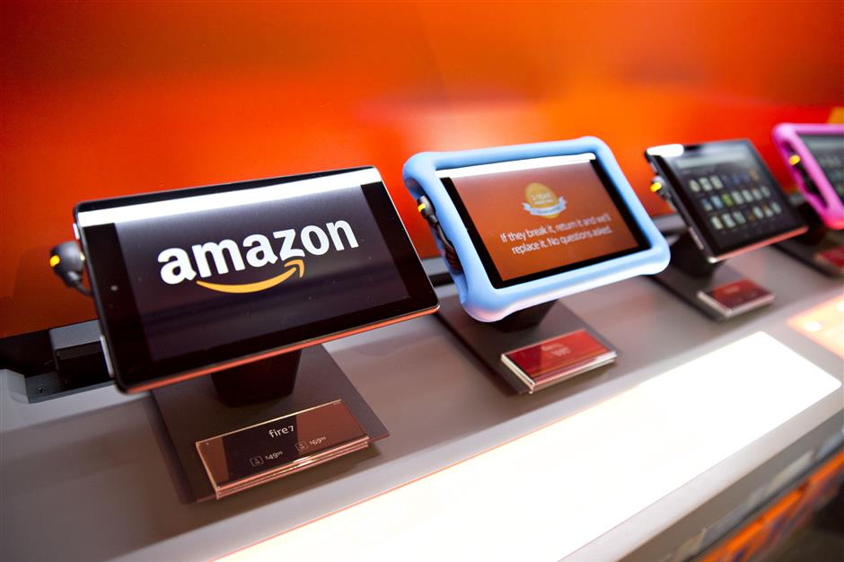 Amazon.com Inc. Fire 7 tablet computers sit on display at an Amazon Pop-Up store inside the Lakeview Whole Foods Market Inc. in Chicago, Illinois, U.S., on Monday, Nov. 20, 2017. Amazon.com Inc.u00a0is betting that people shopping for discounted organic Thanksgiving turkeys at Whole Foods this week may decide to pick up an Echo digital assistant as well.u00a0The company is using the holiday moment and its broader brick-and-mortar presence to further a lead in the emerging market for voice-activated smart home speakers. Photographer: Daniel Acker/Bloomberg