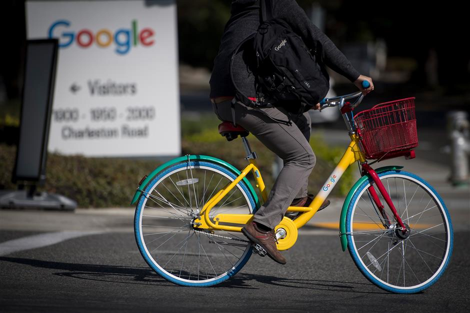 A person rides a Google Inc. bicycle in front of the company\'s headquarters in Mountain View, California, U.S., on Wednesday, April 25, 2018. Alphabet Inc. is pushing efforts to roll back the most comprehensive biometric privacy law in the U.S., even as the company and its peers face heightened scrutiny after the unauthorized sharing of data at Facebook Inc. Photographer: David Paul Morris/Bloomberg