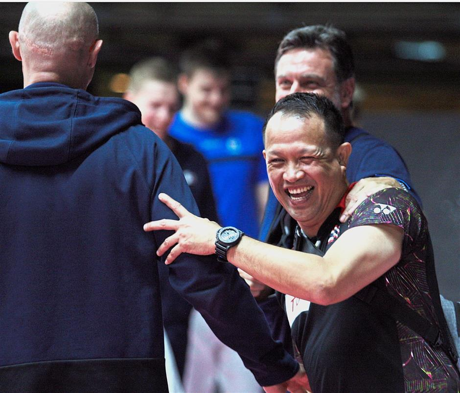 Light moment: Thailand high-performance director Rexy Mainaky interacting with the other coaches at a training session.
