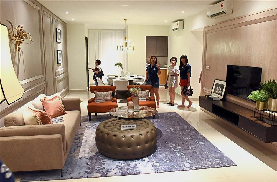 Visitors are awestruck with the living room of a show unit of Gem Residences.