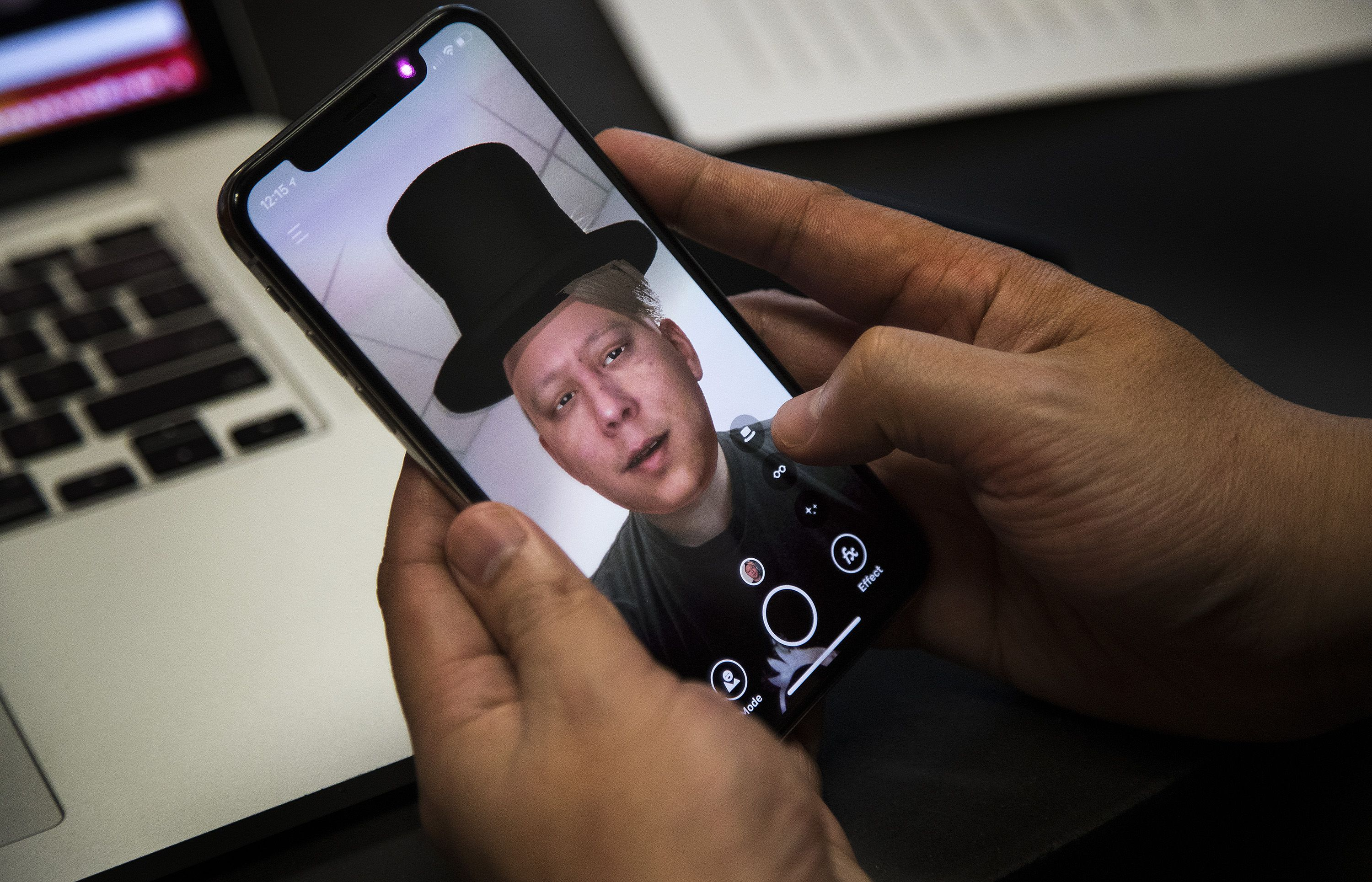 Hao Li, CEO of Pinscreen, shows another person's face on his body through his app Pinscreen on February 1, 2018 in Los Angeles, Calif. The company's goal is to make life-like avatars for gaming or communication, but in the wrong hands, the technology could easily be used to deceive people.(Gina Ferazzi/Los Angeles Times/TNS)