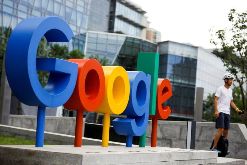 FILE PHOTO: The brand logo of Alphabet Inc\'s Google is seen outside its office in Beijing, China, August 8, 2018.  REUTERS/Thomas Peter/File Photo