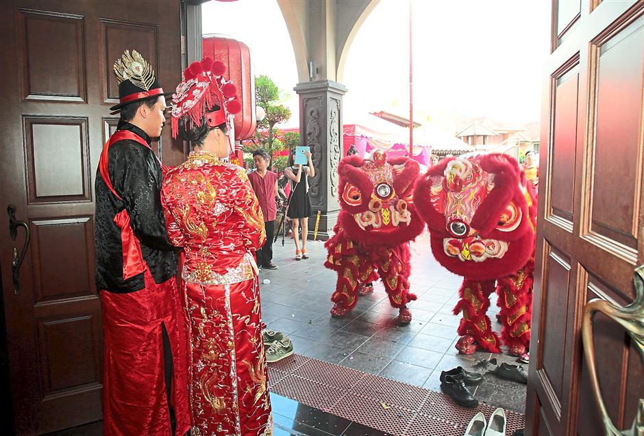 A lion dance troupe blessing the couple, their family and guests.— Photos by ART CHEN