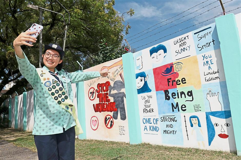 Girl Guide's mural project sends self-empowerment messages to public