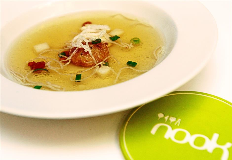 Creamy goodness: The Indonesian-inspired Chicken Soto Consomme is a light pale yellow chicken with buttery bergedel.