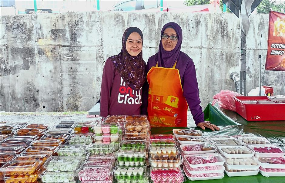Nurul Ashikin and her mother sell about 500 kuih during fine weather.
