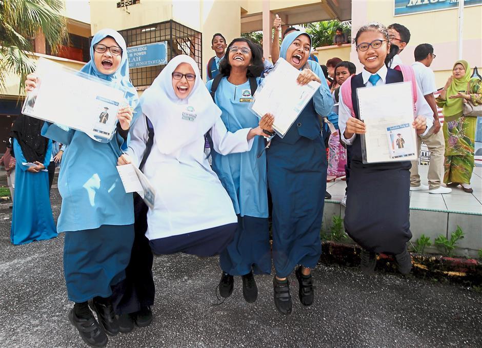 Jumping for joy: (From left) Aina, Atiqah Marissa Marzuki, Venyaa Sivakumar, Zaira Nadheera Ammar and Nur Alya Zulaikha Zafri Zin celebrating their UPSR results in Subang Jaya.