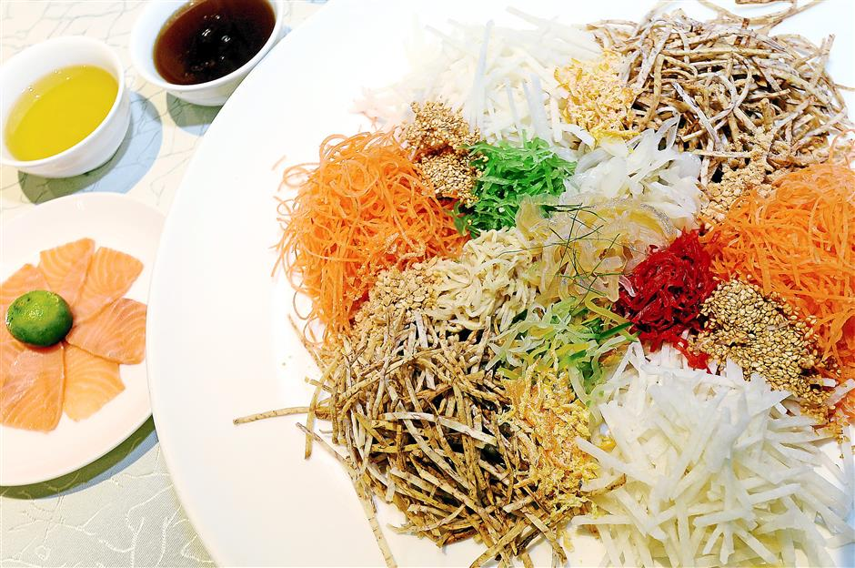 CNY staple: Toss the Yee Sang for a good year ahead.