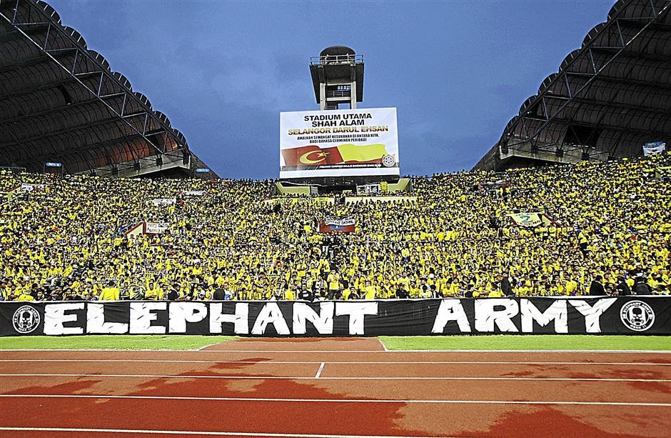 The fans during Malaysia Cup 2013 final match between Kelantan and Pahang at Shah Alam Stadium yesterday. IZZRAFIQ ALIAS / The Star. November 3, 2013.