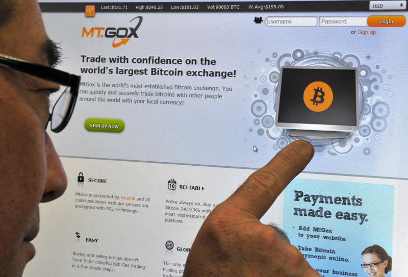 A man looking at the bitcoin exchange website of MtGox in Tokyo on Feb 25, 2014. The website of Tokyo-based bitcoin exchange MtGox went down on February 25, after the value of the virtual unit sank to about a quarter of that on other platforms and Japanese regulators said they were unable to step in - AFP Photo.