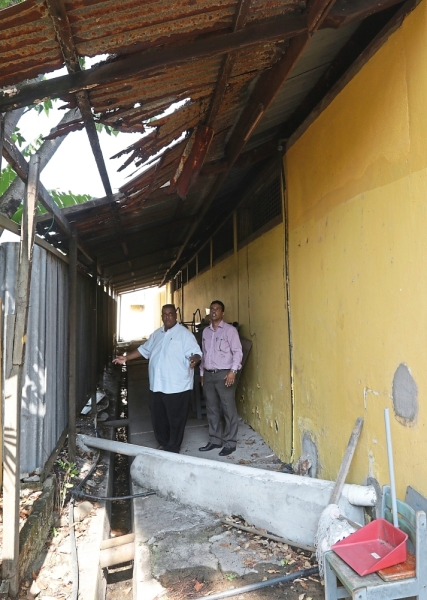 (Right pic) Dilapidated roofing such as this one at a classroom block will also be repaired.