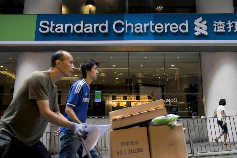 Standard Chartered Plc will have to pay a US$300mil penalty and suspend or exit some important businesses after charges relating to money laundering by US regulators - AFP Photo.